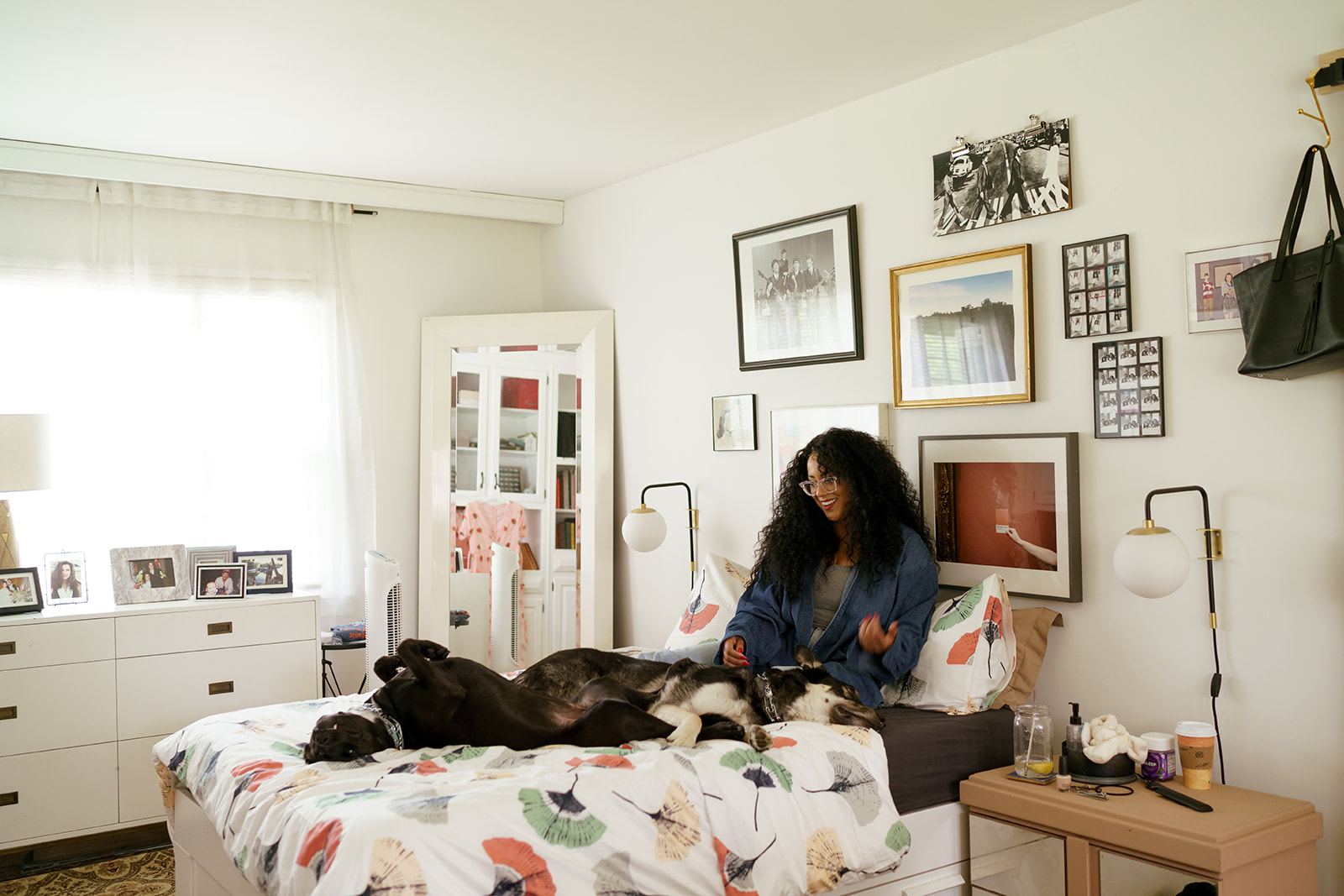 woman sitting on bed with dog